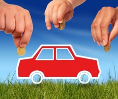 Red car and hands with money
