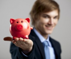Man holding red piggy bank