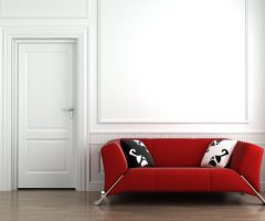 Red Couch on White Wall